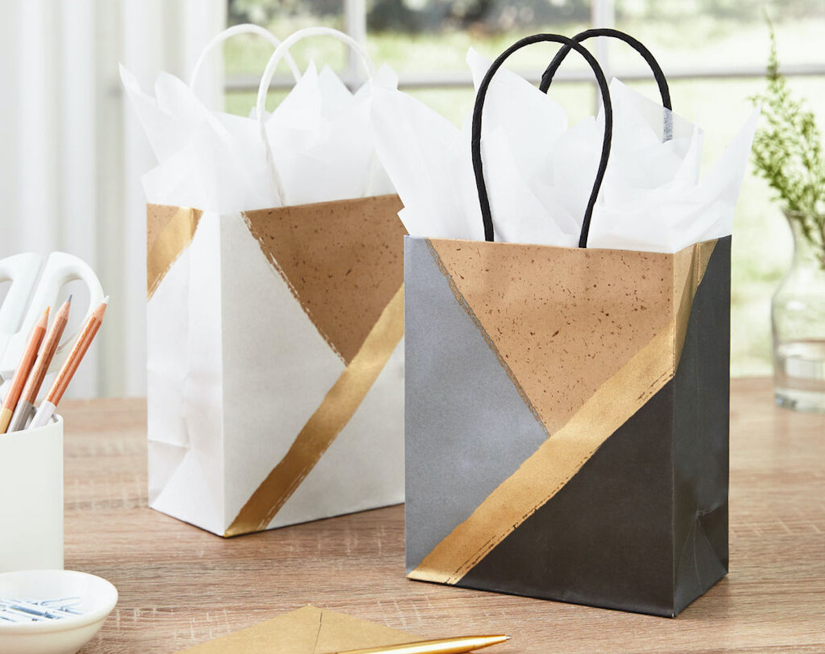 White and Black Hallmark Gift Bags on table