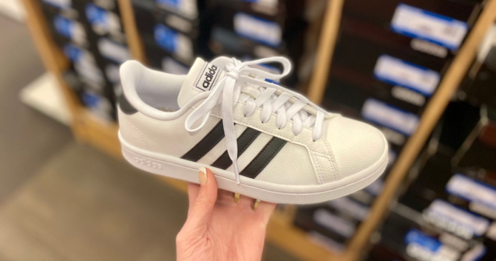hand holding black and white Women's adidas Grand Court Sneaker