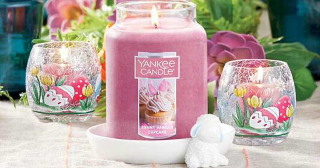 Yankee Easter candle on a table with easter glasses and more