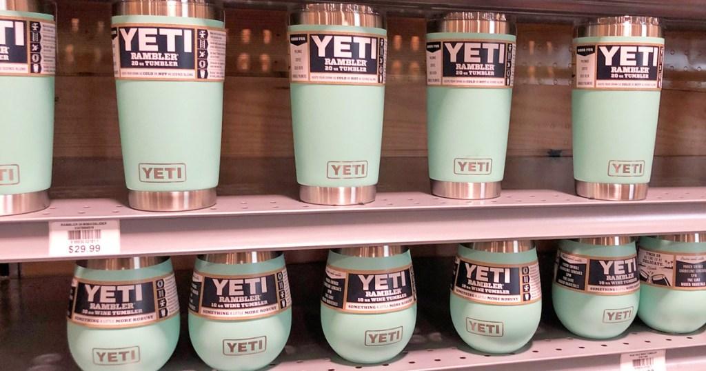 store display shelves of light blue yeti brand tumblers