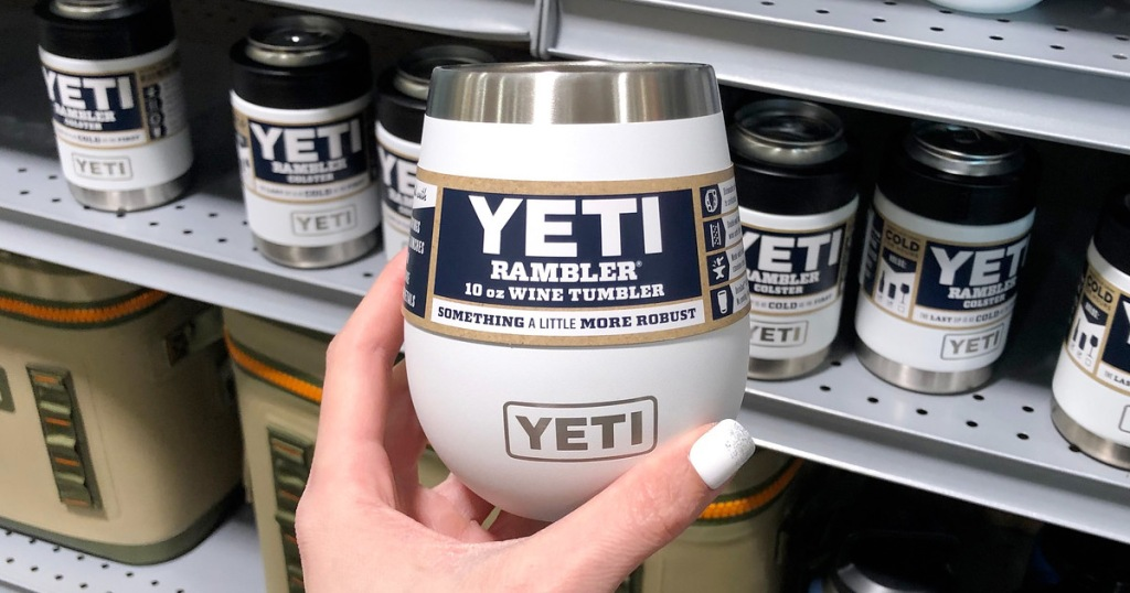 person holding up a white yeti brand wine tumbler