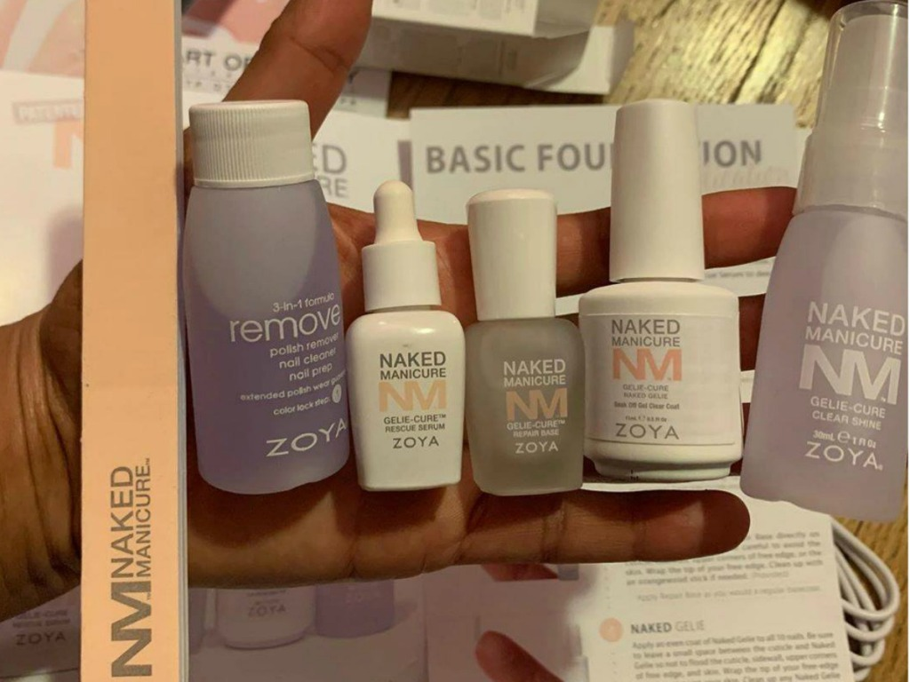 Woman holding pieces of ZOYA Naked Manicure Geliecure Retail Kit