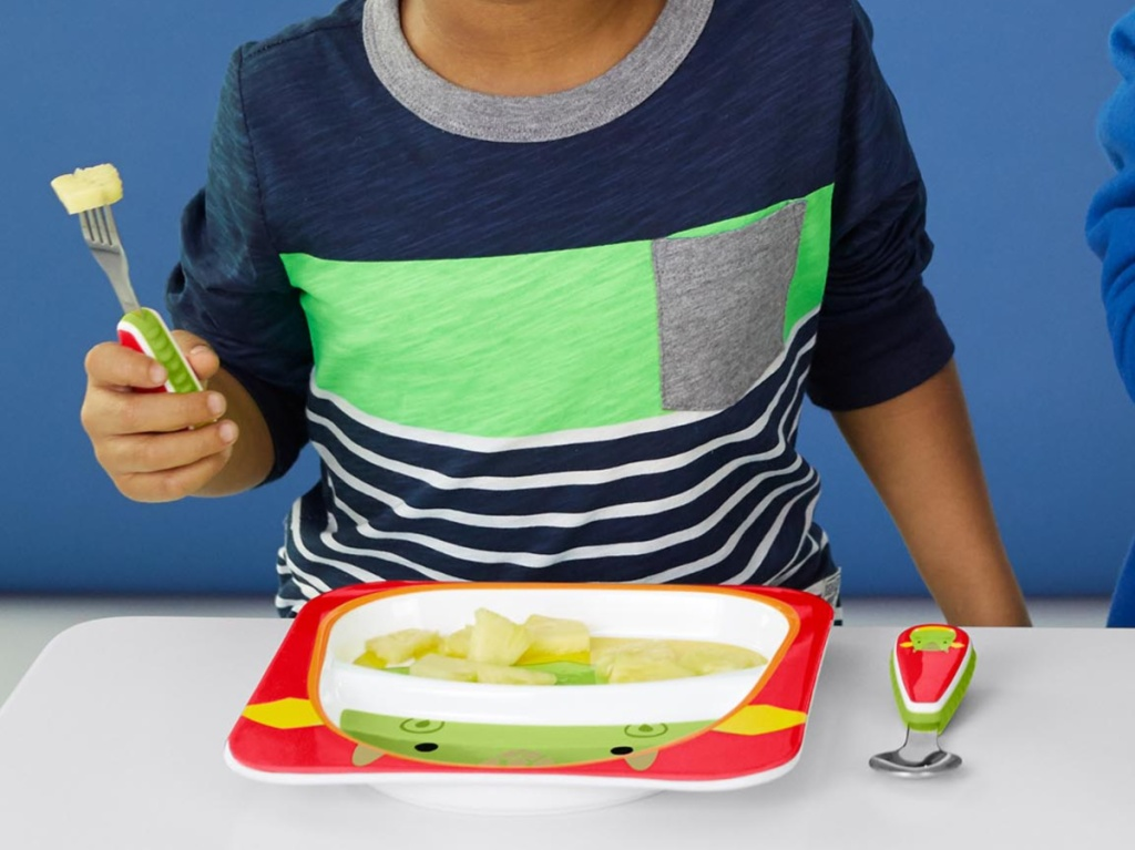 child using animal themed plate and utensils