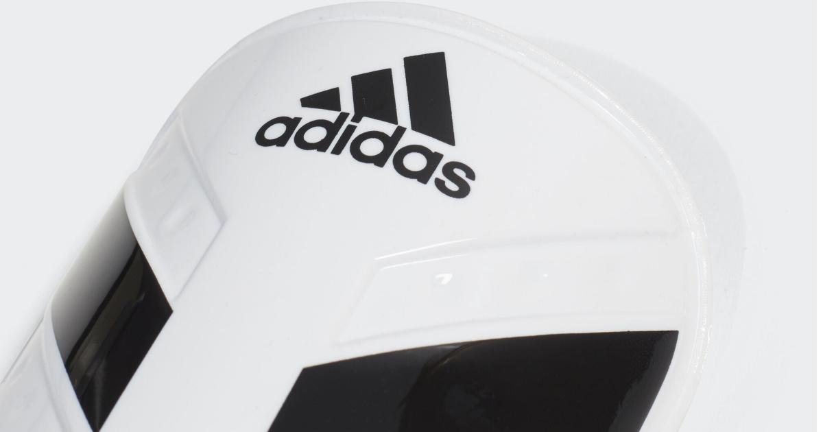 white and black adidas shin guard