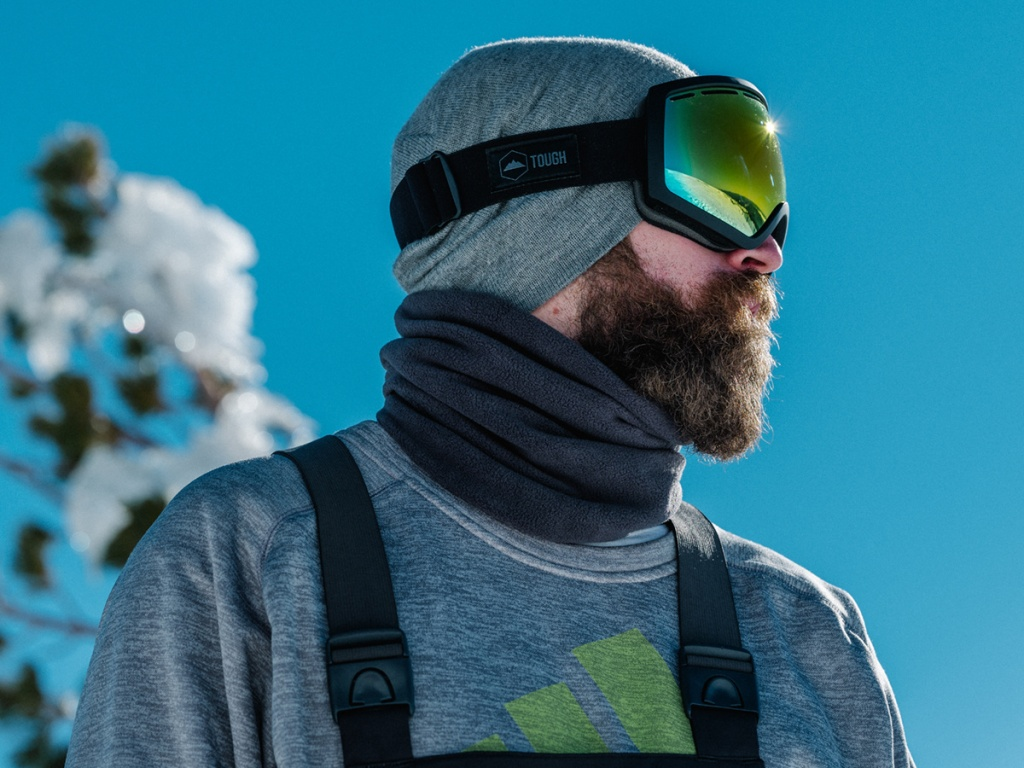 man wearing goggles and beanie outdoors