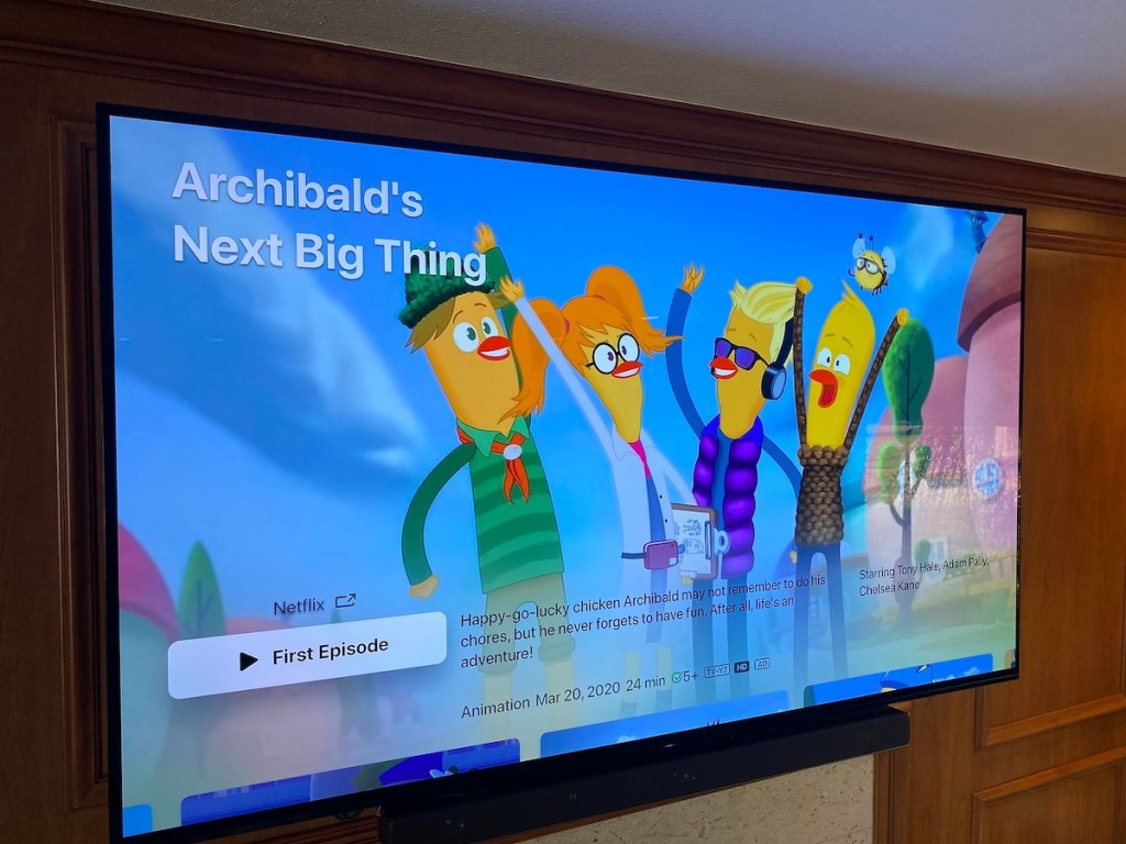 flat screen tv on wall with colorful cartoon on screen
