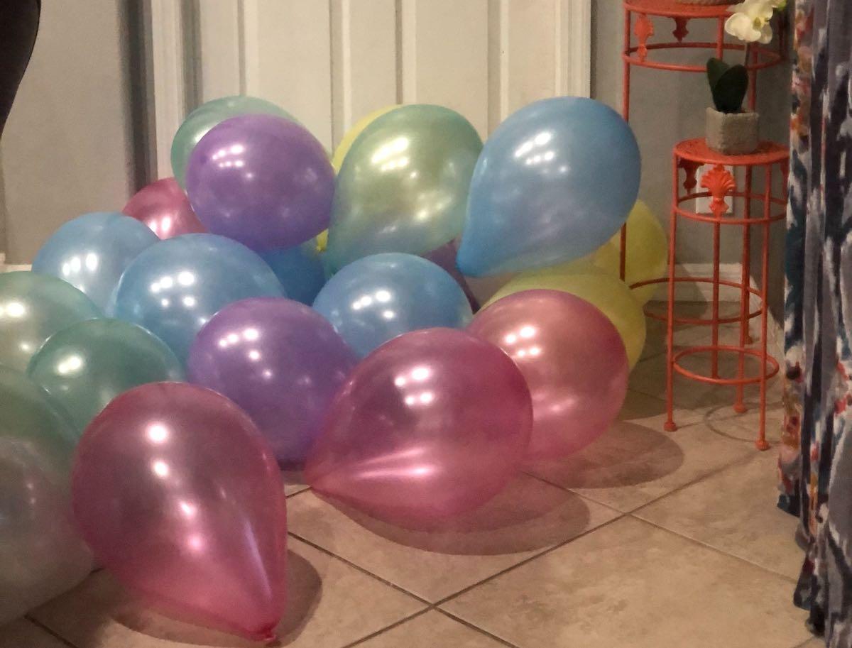 colorful balloons laying on the floor purchased at dollar tree online