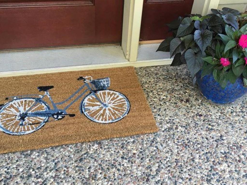 bike front door rug on door stoop