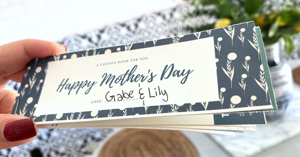 hand holding coupon book for mom mother's day gift