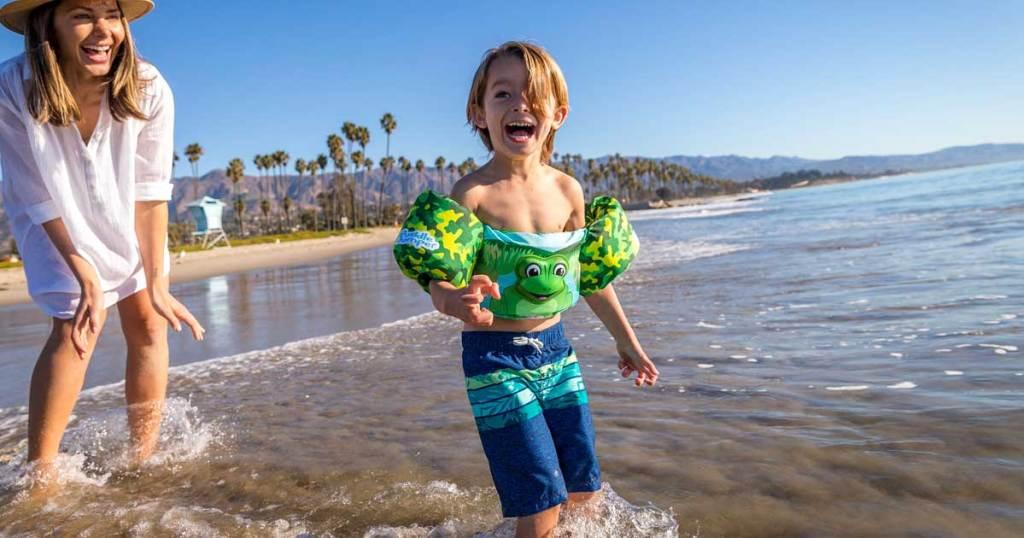 boy-in-frog-floatings-on-ocean