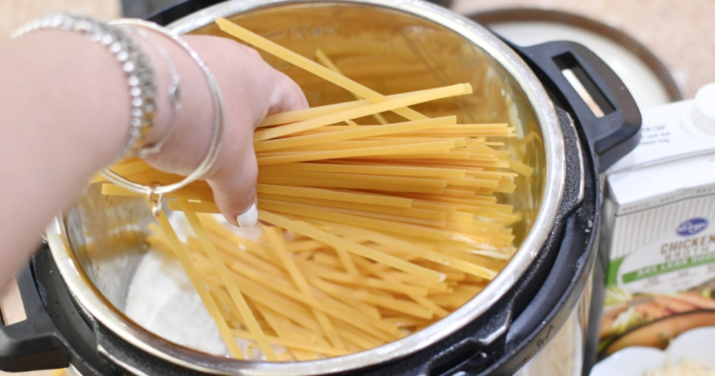 breaking apart noodles and adding to instant pot