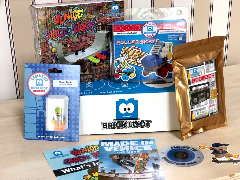 brickloot box with various lego toys surrounding it
