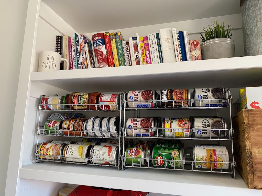 canned good organizers sitting side by side on shelf in pantry