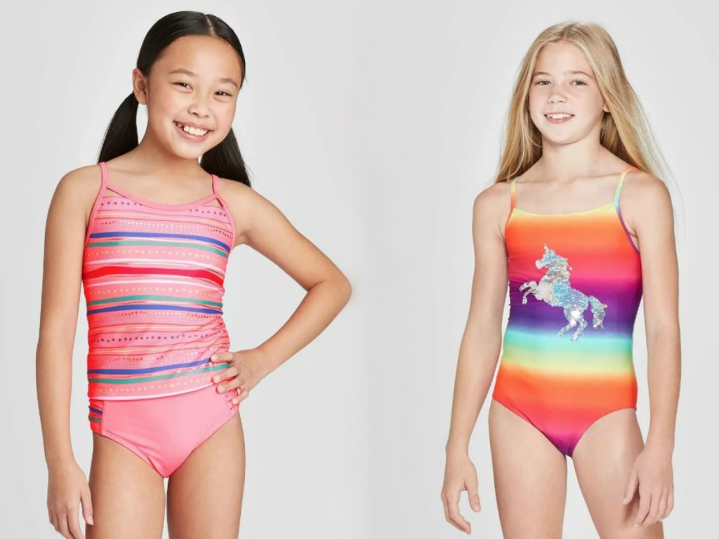 two girls in swimsuits with smiles