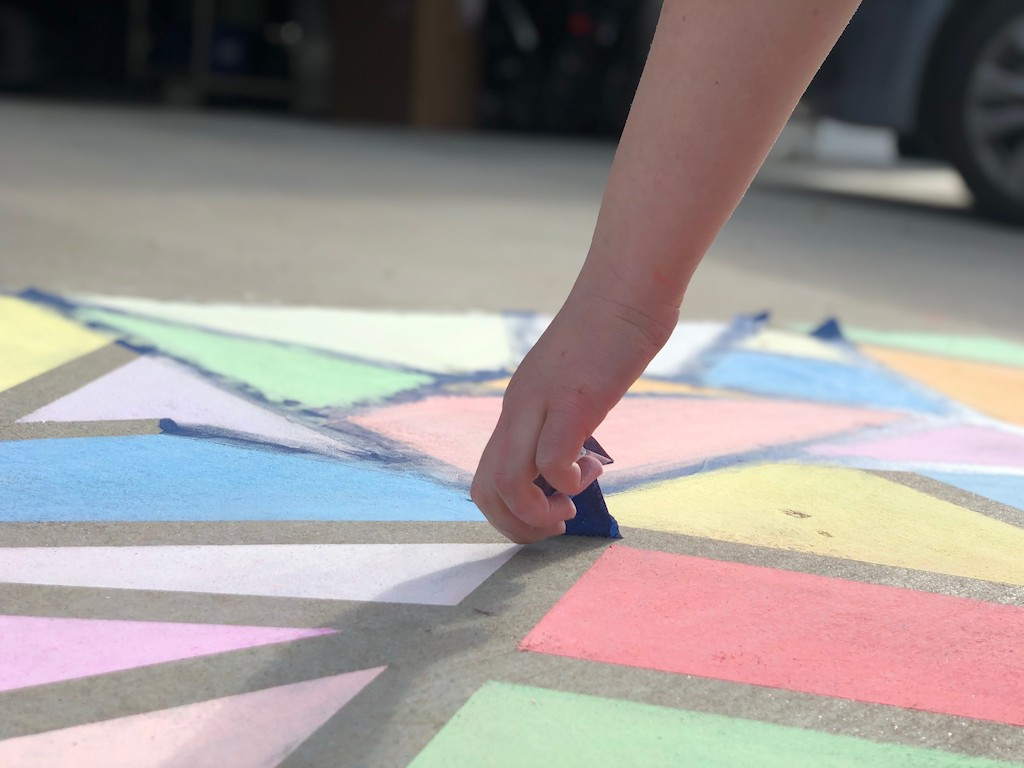 peeling off painters tape from sidewalk chalk