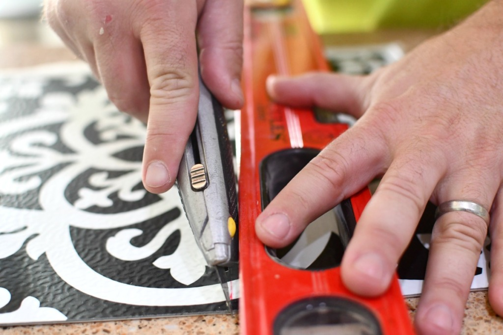 cutting peel and stick tiles