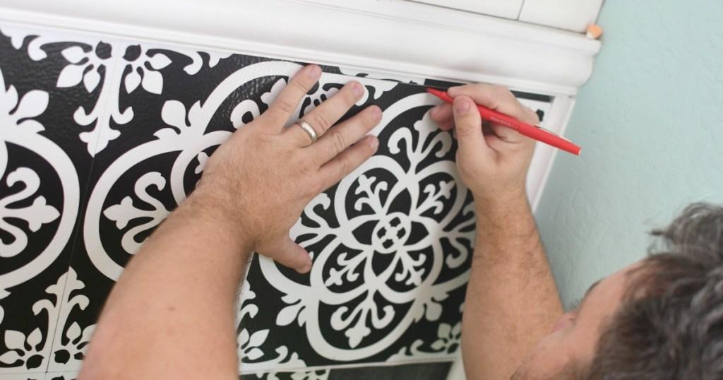 cutting the edges of vinyl tile