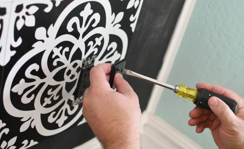 cutting vinyl tiles around electrical outlet