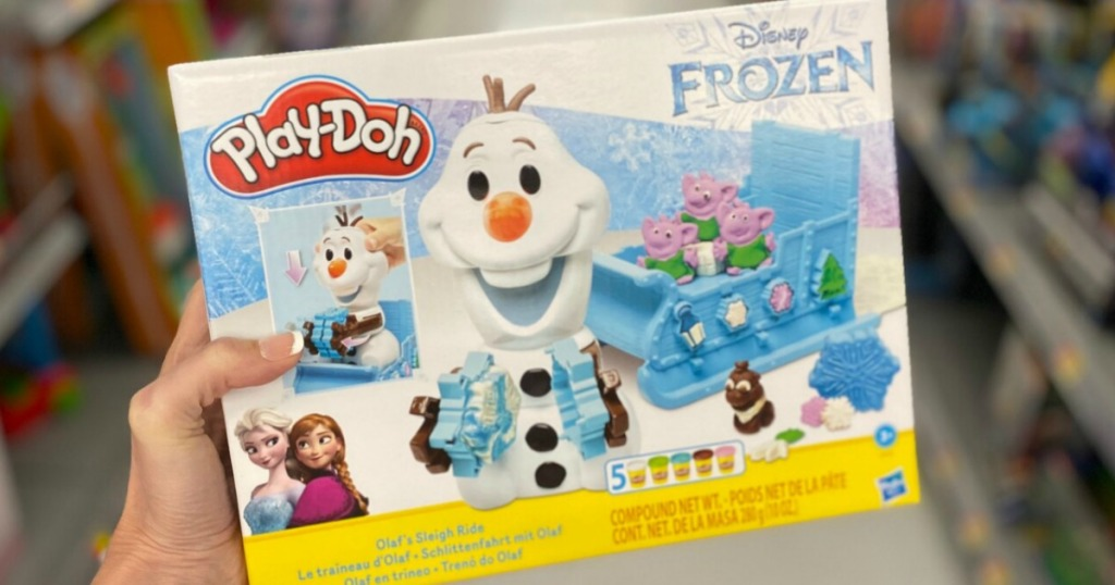 hand holding olaf play-doh set