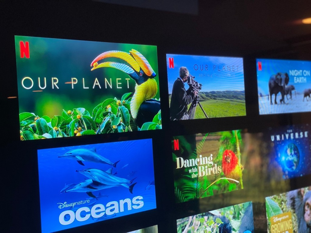 close up of tv screen with colorful planet documentaries