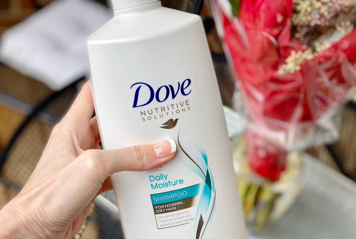 hand holding bottle of dove shampoo