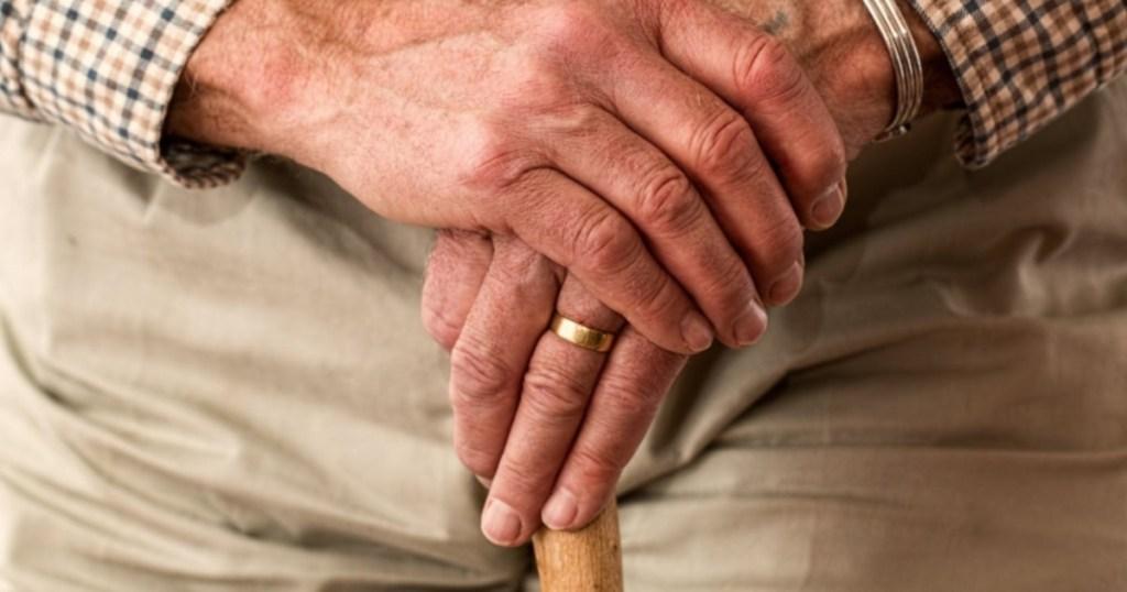 older gentleman holding cane