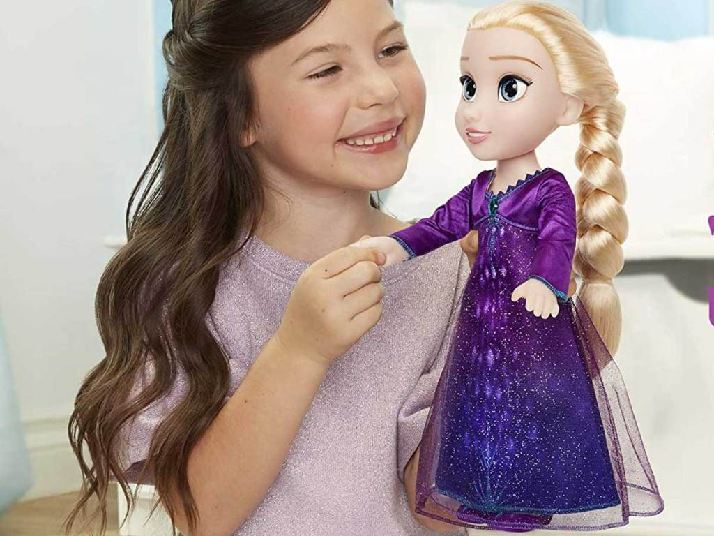 little girl holding Disney Frozen 2 Into The Unknown Singing Feature Elsa Doll