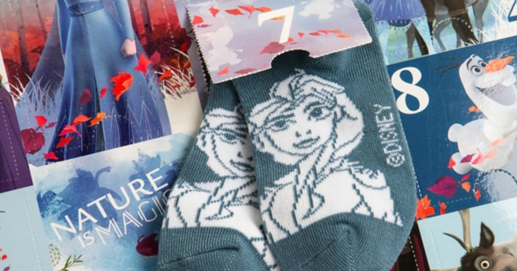 pair of socks with Disney princess face on it on top of box