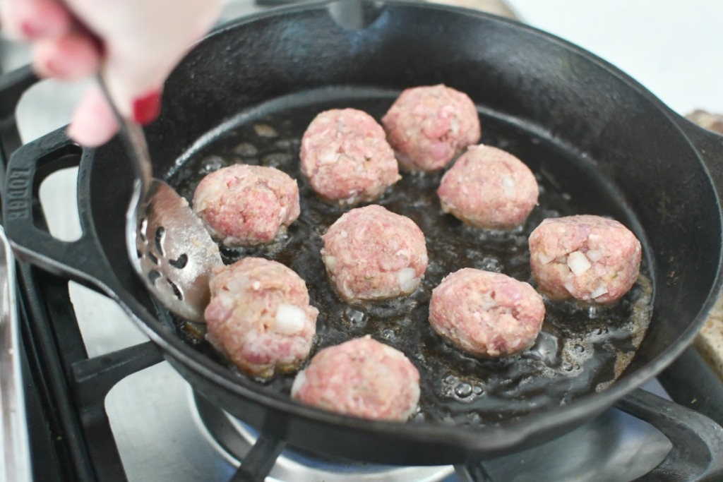 frying meatballs in a cast iron pan