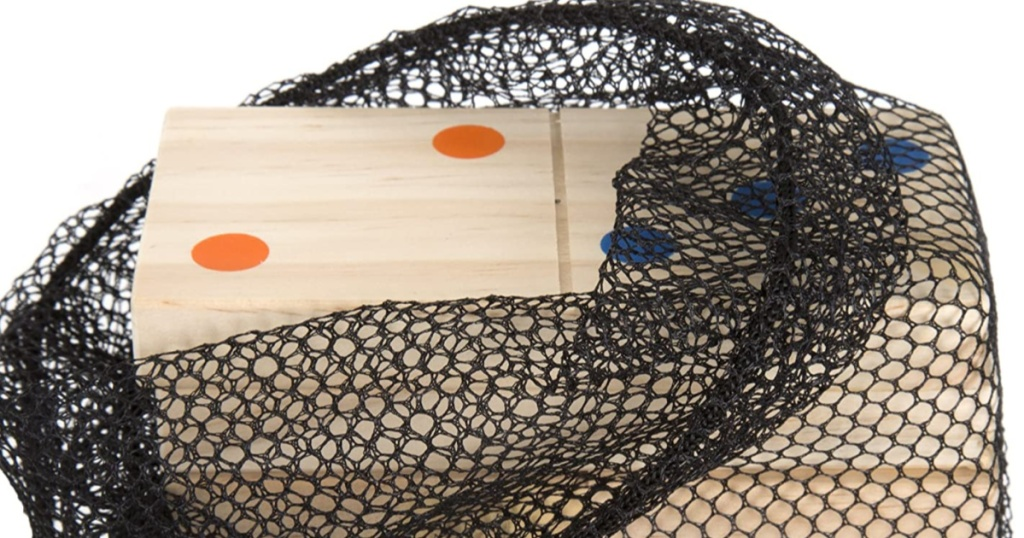 wooden dominos with colorful dots in black mesh bag