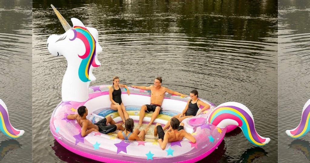 people sitting in giant unicorn float