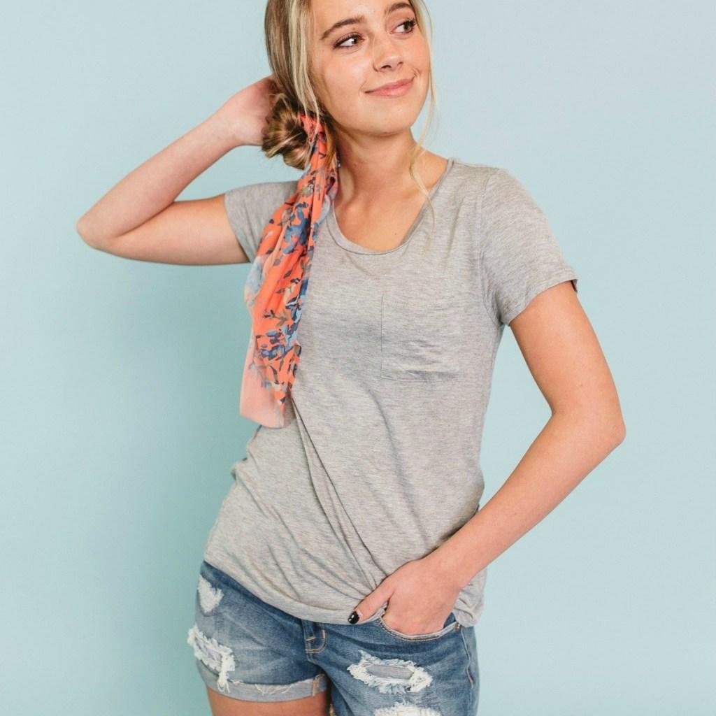 oman wearing a gray t-shirt