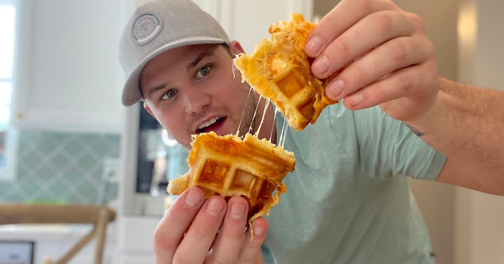 man holding a waffle shaped grilled cheese