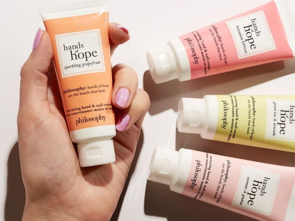 hand holding hands of hope cream