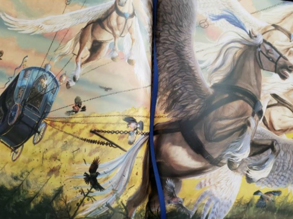 illustrated book with horses and flying carriages