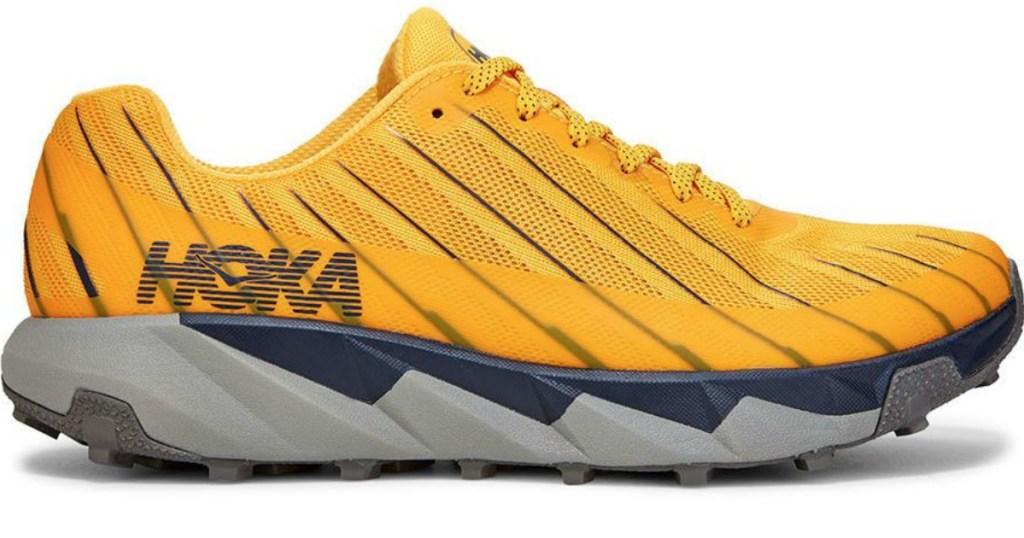 yellow mens' running shoe that says HOKA