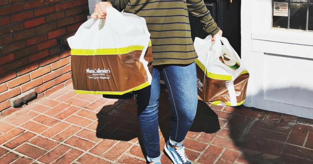 woman holding Marie callender's takeout bags