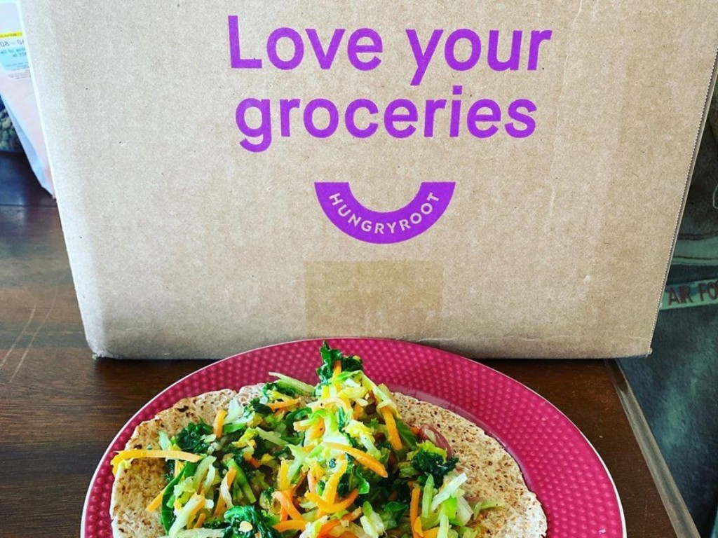 Hungryroot shipping box next to vegetarian wrap