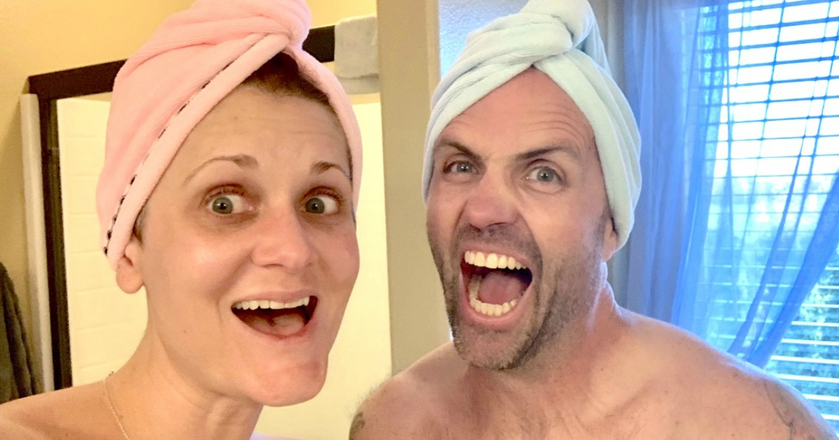 woman and man with hair towels on their heads