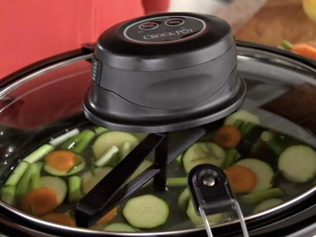 auto-stir slow cooker filled with vegetables