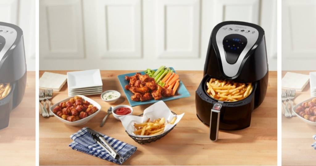 Best Air Fryer - digital air fryer with basket opened filled with fries on table with fried foods nearby
