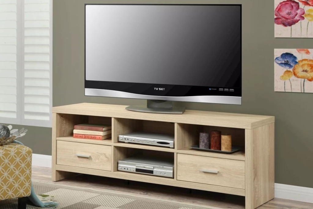 johar furniture tv stand with tv on it in living room