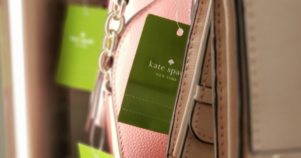 "tag on pink purse that says ""Kate Spade New York"""
