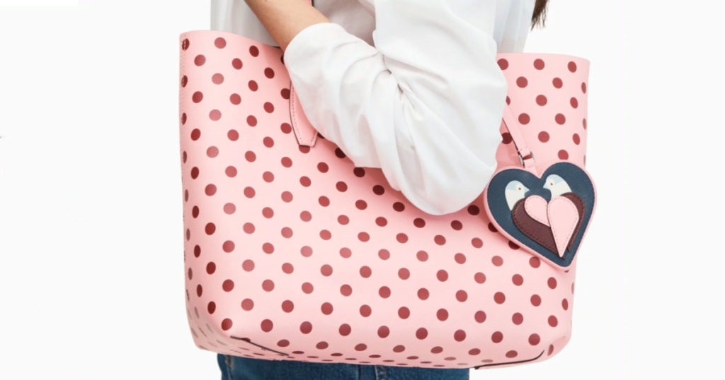 woman carrying polka dot pink bag with love birds