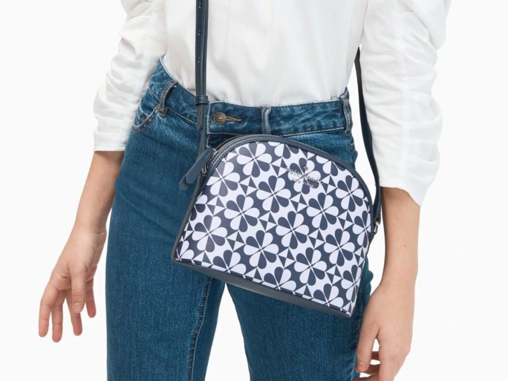 woman wearing kate spade blue themed bag