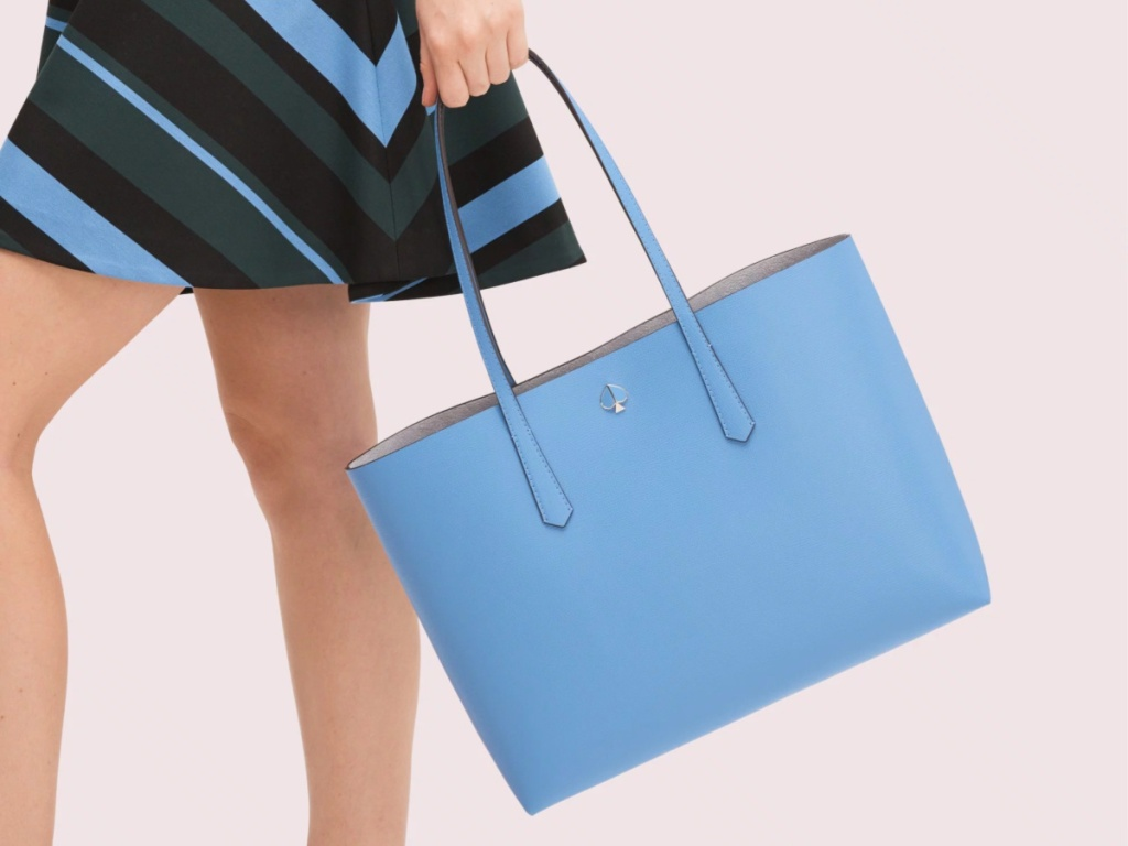woman with blue kate spade tote bag