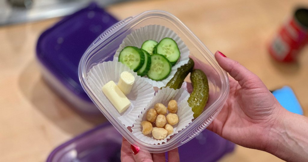 keto snack container filled with nuts, pickles, cheese and cucumbers