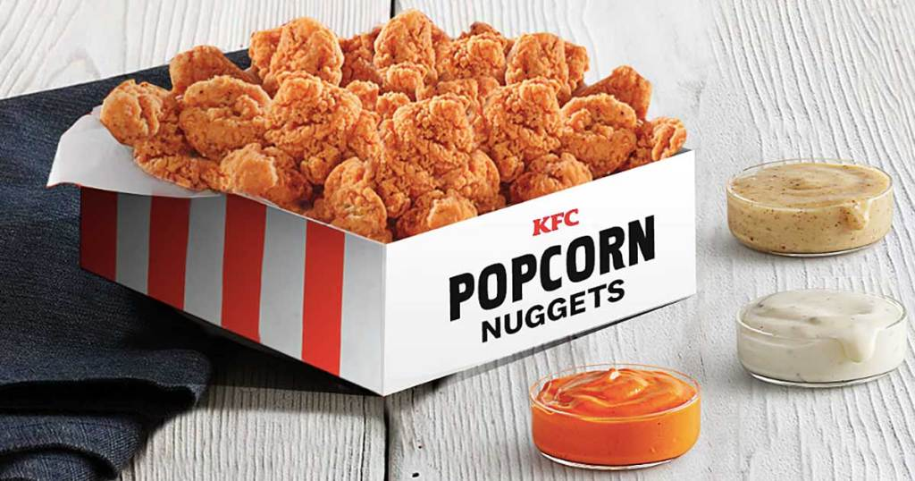 kentucky fried chicken popcorn nuggets in a box with sauces