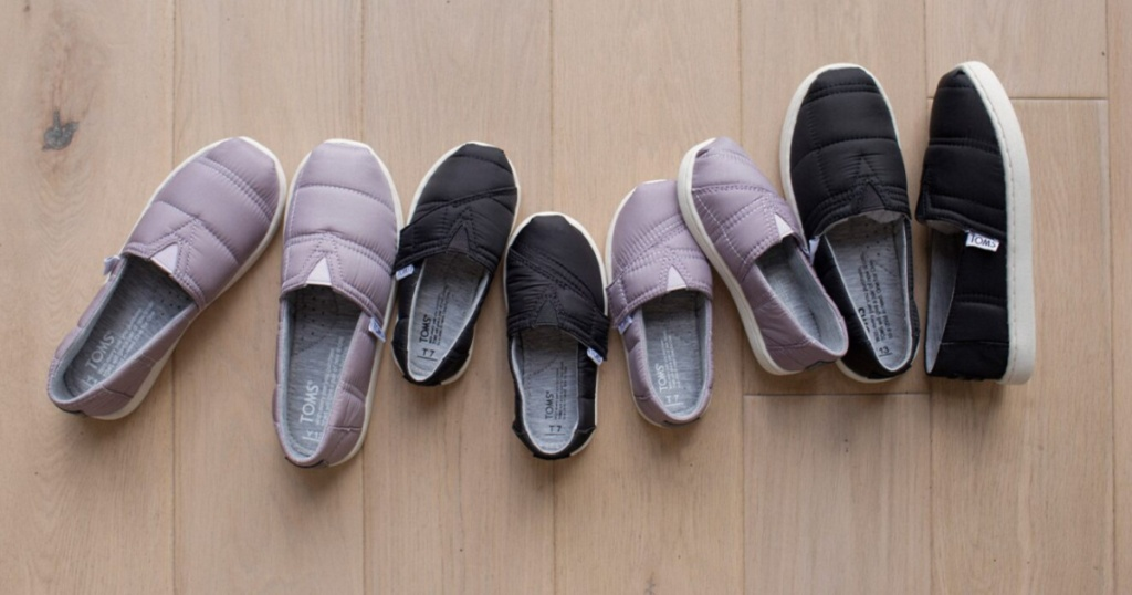 kids TOMS 4 pairs on floor