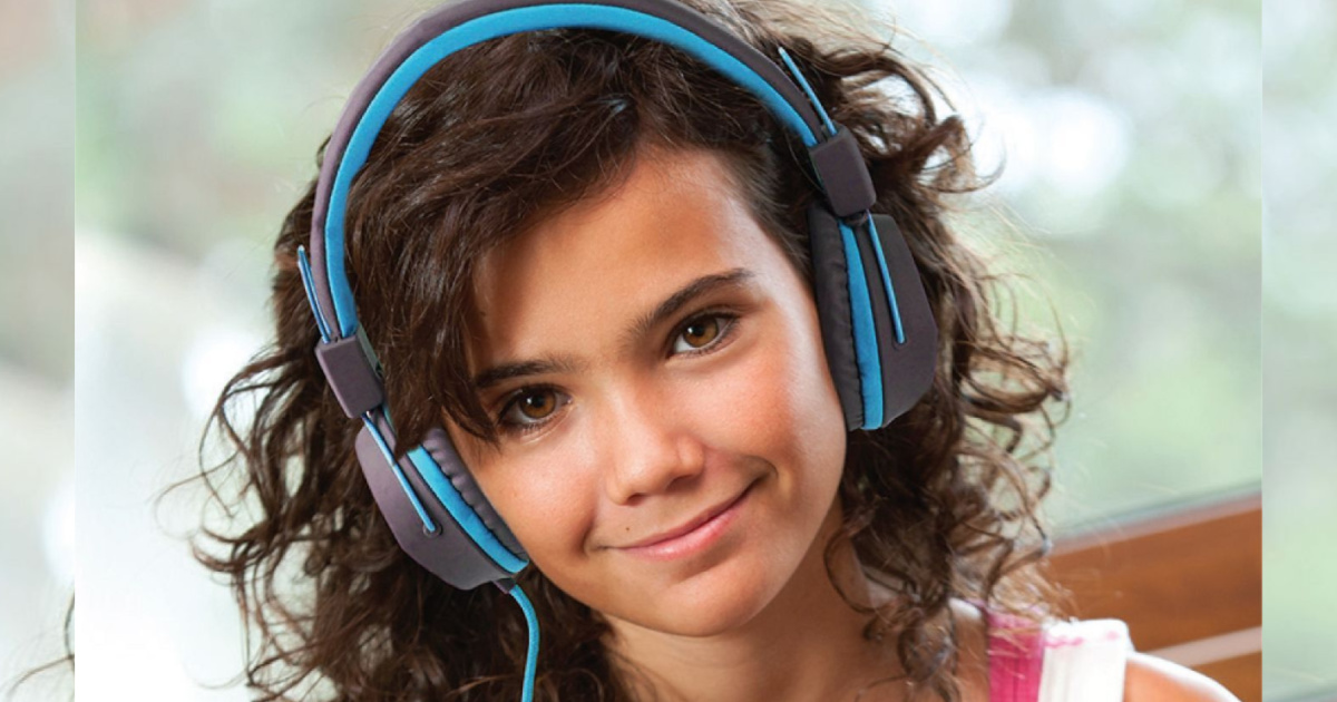 girl wearing gray and blue headphones